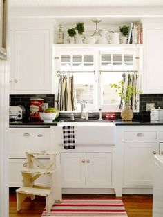 love the shelf over the sink, farmhouse sink, black tile and countertops!! Just like our new kitchen!
