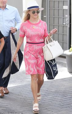 Pretty in pink!The Oscar winner teamed the feminine frock with a pair of strappy nude wed...