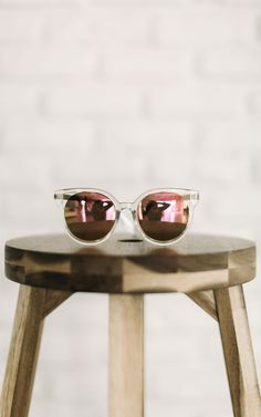 72d93445cb361 Round frame sunglasses with pink reflector lenses.