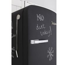 This is so cute! Just spray your fridge with chalk board paint!
