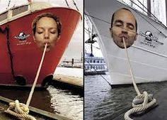 It's yet more playful environmental design.  The anchoring ropes are attached to the mouths of hungry consumers.  Suddenly, the boats in the harbor have been recontextualized in a surprising new way, creating a unexpected and memorable impression.