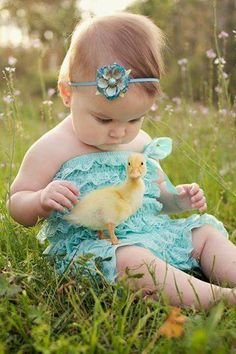 """She's looking at this duck like """"you're the ugliest strangest baby I've ever seen!""""  way too cute!"""