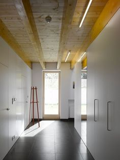 Family House, Klokočná, Prague, Studio pha, white room, wood beams   Remodelista