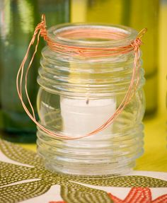 Jelly Jar Lantern  Turn an empty clear jelly jar glass into a quick-and-easy lantern. All it takes is a little copper wire. These lanterns also can be used as flower vases or utensil holders.