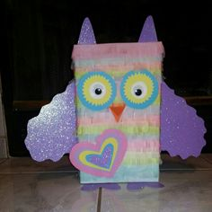 """Valentine's Day box!  Needed: cereal box, covered in a solid color, tissue paper cut in strips about an inch wide(to wrap around the box) and cut slits in the bottom for the feathers, make your eyes and wings and feet and ears!! Enjoy!!! Pretty easy to make and probably took us about an hour to make. We used a glue stick to attach each row of """"feathers"""" starting at the bottom and moving up! Saw the idea from another pin, but it was a pinata that they used it for....not stealing ideas just…"""