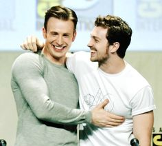 Chris Evans and Aaron Taylor-Johnson attend the Marvel Studios panel during Comic-Con International 2014 at San Diego