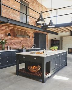 Industrial style shaker kitchen against exposed brick wall with steel beams overhead and industrial lighting. Kitchen by Tom Howley. Industrial Farmhouse Kitchen, Industrial Kitchen Design, Industrial Kitchens, Industrial Furniture, Pipe Furniture, Country Kitchen, Furniture Design, Urban Kitchen, Industrial Table