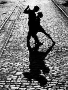 "The tango may end, but passion's fire blazes on in ""The Last Dance."" The romantic final pose of two silhouetted tango dancers is imparted with a sense of eternity by surrounding train tracks which extend into infinity. Elongated shadows cast upon quaint c Dancing In The Moonlight, Dancing In The Dark, Fred Astaire, Tanz Poster, Danse Salsa, Dance Like No One Is Watching, Argentine Tango, Shall We Dance, Salsa Dancing"