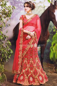 Resham and Zari weaved Deep Pink Colored Silk Lehenga Choli which will be Perfect for a wedding look. Paired with Net Fabric Deep Pink Colored Choli.