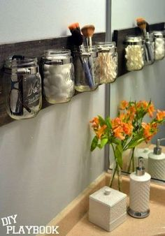 s 13 ways to completely declutter your bathroom in an hour bathroom ideas organizing Make a mason jar organizer for the wall