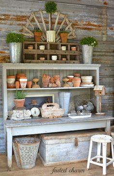 Inside the garden shed of this cozy Oregon cottage, a potting bench provides useful storage space by holding dozens of terra-cotta pots and other vintage finds.