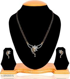 Checkout this latest Mangalsutras Product Name: *Women's American Diamond Mangalsutras* Sizes:Free Size Country of Origin: India Easy Returns Available In Case Of Any Issue   Catalog Rating: ★4.1 (1440)  Catalog Name: Women's Gold Plated Mangalsutras CatalogID_389777 C77-SC1097 Code: 871-2868810-753