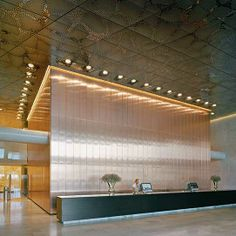 Stockholm Waterfront, Office Block, Reception Hall, Stainless Steel Ceiling and Copper Wall, Ceiling Panels Type EXYD-A/P, Photo Michael Per...