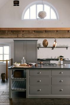 A beautiful open ended island with wooden slats perfect for storing big pots and pans