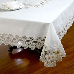 This embroidered lace tablecloth is a grand classic in an elegant style. Expertly woven of a special linen/polyester blend material combines the feel of fine table linens with easy care.