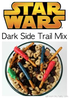 "Star Wars fans will love this simple and delicious Dark Side Trail Mix Recipe - easy enough to whip up for a Star Wars movie marathon or to take to the theater to see The Force Awakens. The chocolate covered pretzels act as light sabers and there are dark chocolate chips for ""the dark side!"" Perfect for a party idea, to serve for your family for a special treat."