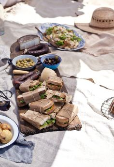 Beautifully wrapped sandwiches, olives, sausage, cheese