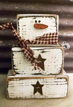 These adorable little stacking wood blocks snowmen look cute sitting almost anywhere in your primitive home! Blocks are approx 4 1/2 3 x 2 wide x 1 deep. Buyer pays shipping. Cute little homespun scarf and 3 rusty metal stars on his belly.