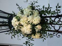 White hydrangeas white roses and Italian ruscus