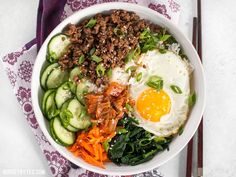 Bibimbap is the ultimate bowl meal with plenty of color, flavor, and texture to keep your taste buds happy and your stomach full.