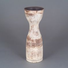 Hans Coper Vase, circa 1958. T-material, dry buff slips over a textured body rubbed with manganese, a cut spiral around the body, impressed HC seal