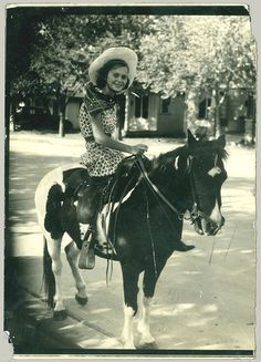 I have a picture of myself on a horse like this taken in Los Angeles.  In the 1950's they would bring the horse to your house & take your picture.