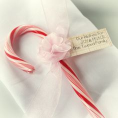 Personalized Candy Cane Tissue Paper Flower Tag for Stocking Stuffer Wedding Classroom Exchange. $12.00, via Etsy.