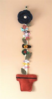flower pot hairclip holder with a zipped pocket in the 'pot' for hairties too!