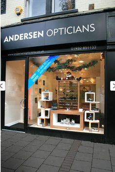 Andersen Opticians, England- like the use of shapes and different heights but also with the small festive touches. Being able to see into the store also makes it more inviting.