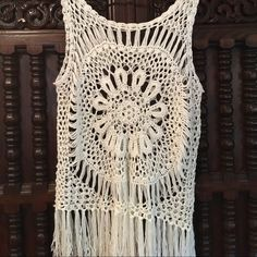 Adorable crocheted tank - one size Beautiful tank - can fit a variety of sizes. I am a L/XL and it fit me. Great condition - barely worn. Cute fringe details. Tops Tank Tops
