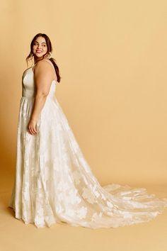 Kamy – Halseene A curve wedding gown featuring head to toe shimmery gold organza, with a sweetheart neckline and spaghetti straps.#HalseeneKamy #plussizeweddingdresses #plussize #effyourbeautystandards #weddingdress