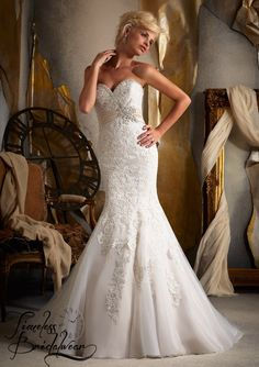 Mori Lee 1903 Reduced to €895 Fitted strapless gown with alabaster sash. Diamanté and lace appliques adorn this figure flattering dress. We 💖 it!  Size 14, can be altered down.  Currently retailing €1,600 but it's only €895 on our rails.  www,timelessbridalwear.ie