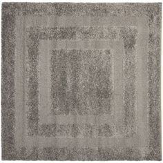 This power-loomed shag rug offers luxurious comfort and unique styling with a raised high-low pile. High-density polypropylene pile features a dark grey background with dark grey accents and provides one of the most plush feels available in a rug.