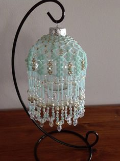 Beaded ornament, Beaded bauble This stunning Chandelier beaded glass bauble is made from hundreds of mint green Czech seed beads, mint green bicones, crystal teardrops, Czech fire polish crystals and a variety of other decorative beads. It would be a great Christmas or Birthday gift,