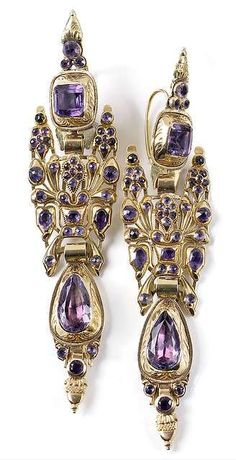 A rare pair of Spanish or Portuguese gold and amethyst earrings, 1st half of 18th ct. Tog.c. 35g. L. 11,5 cm -  Provenance: South German private collection. A similar pair to these earrings but with hessonite stones in the collection of the Jewellery Museum at Pforzheim. - Minor restorations and additions. Estimate 3500 €    Nagel Auktionen. February 20th 2013. www.auction.de    http://www.auction.de/catalogues/epaper-692/index.html#/16  7c9abb4fda8c1d4d272c16f7333e1905