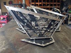 Metal trophies custom made for a construction company.  Painted steel with polished aluminum accents.  www.refinerii.net