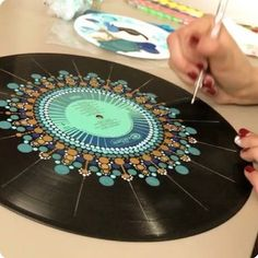 Mammals painted vinyl records for decorative wall art This record is just getting better and better! I am sick as a dog today, so you're lucky I spared you the audio of this time lapse, which… Dot mandala on record Dot painting on an old record album Mandala Art, Mandala Painting, Vinyl Record Crafts, Vinyl Art, Vinyl Decor, Art Diy, Dot Art Painting, Soul Art, Recycled Art