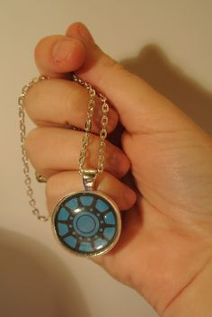 http://www.etsy.com/listing/108442881/iron-man-arc-reactor-necklace?ref=sr_gallery_1=sr_76f5e1488e6d749d8fe57b0c5d36b38d6c8f6b42fcadccf784aefe47dc606b77_1350941784_14298712_arc_reactor_includes[]=materials_search_query=arc+reactor+necklace_search_type=all_view_type=gallery#