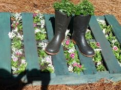 How about a pallet walk way, stained a beautiful shade, with flowers planted between the slats?