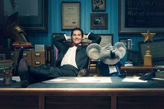 Matthew McConaughey and his character, Buster Moon, appear in Buster's office. SING is in theaters December 21.