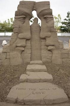 Awesome sand sculpture. this is definitely symmetrical and balanced out. Aside from the fact that one is a man and one is a woman, if you cut down the middle (including the path) everything would be the same. - Jamie Livingston