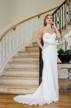 Nia - this beautiful sheath wedding dress has modern cutaways, sparkling embellised waist detail, a stunning button back and is in a gorgeous crepe fabric. Available to try at Honeyblossom Bridal boutique in Sale, Cheshire xx Bridal Wedding Dresses, Wedding Dress Styles, Designer Wedding Dresses, Bridal Style, Gorgeous Wedding Dress, Crepe Fabric, Bridal Boutique, Dress Collection, Strapless Dress