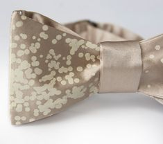 Menswear: Champagne Wishes and Caviar Dreams bow tie via Etsy.  I'm more into ties the bowties, but I like the design on this one.