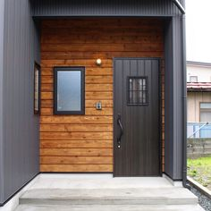 I want clear tongue and groove red cedar but I like the idea of a black door with the rest of the house white board and batten Exterior House Colors, Exterior Design, Interior And Exterior, Storage Container Homes, Home Porch, Basement House, Exterior Cladding, Loft, Entrance Doors