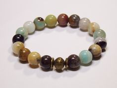 Beautiful Amazonite gemstones with a brass focal bead. • This is the perfect everyday bracelet. • Wear this alone or layer with other bracelets for that bohemian look. •10m... #bracelet