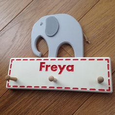 Personalised wooden elephant with three birch pegs - can be used for hanging coats, dressing gowns, keys, tea towels, dog leads or numerous other items.  I cut and hand paint these items and then decorate them so each one is guaranteed to be unique. All colours can be customised if requested to allow this item to fit with the colour schemes of your room. Each elephant has a twine tail and raised ears.  I can add any engraved personalisation onto the backplate, as shown in my photos (this is…
