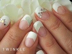Adorable Sea Foam Green and White manicure.