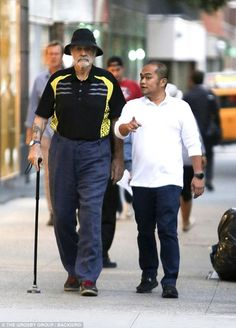Leaning on his cane for added support, the 007 actor cut a casual figure in a black polo shirt with a quirky canary yellow design, as he remained determined to stay active in New York.