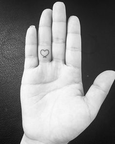 Heart tattoo by Goun