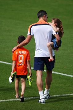 Robin van Persie walks with his daughter, Dina Layla and son Shaqueel during the Netherlands training session at the 2014 FIFA World Cup Brazil held at the Estadio Jose Bastos Padilha Gavea on June 14, 2014 in Rio de Janeiro, Brazil. (Photo by Dean Mouhtaropoulos/Getty Images)
